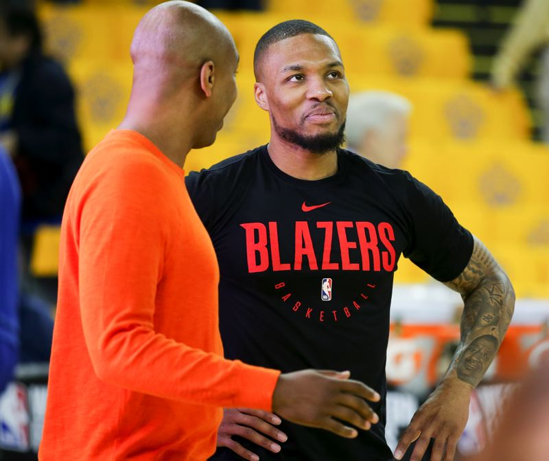 COURTESY PHOTO: GEROME WRIGHT - Damian Lillard pauses to chat during the pregame warm-ups at Oracle Arena on Thursday night.