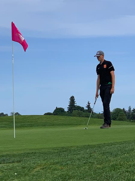 COURTESY: WAYDE ELLIOTT - Chase Elliott of Scappoose High lines up a green at Trysting Tree Golf Club in Corvallis during this week's Class 5A championship tournament.