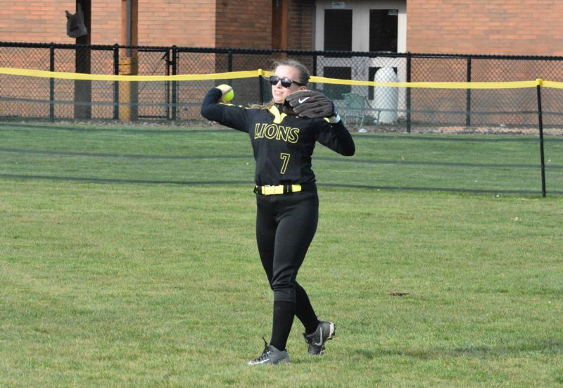 PMG FILE PHOTO: MATT SINGLEDECKER - Bailey Hamilton, St. Helens senior, completes a play from the outfield.