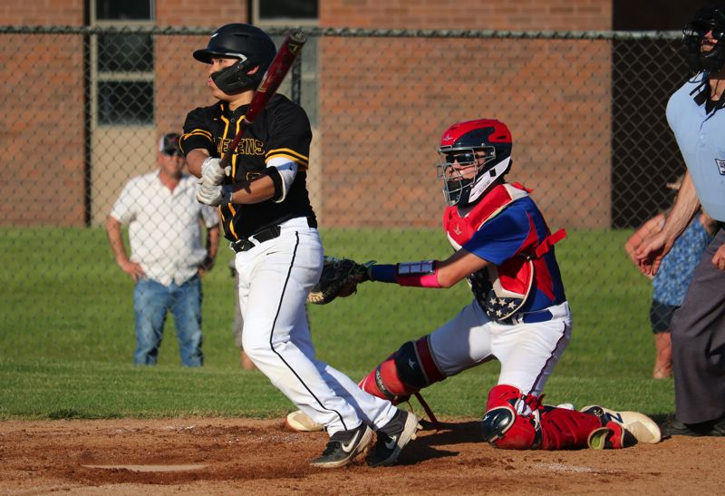PMG FILE PHOTO: JIM BESEDA - Jacobi Allen, a sophomore at St. Helens High, follows the flight of a hit.