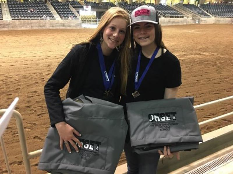 COURTESY PHOTO: MELISSA HOLM - Katie Holm (left) and Tiffany Thompson had high finishes in competition at the recent Oregon High School Equestrian Team state meet in Redmond.
