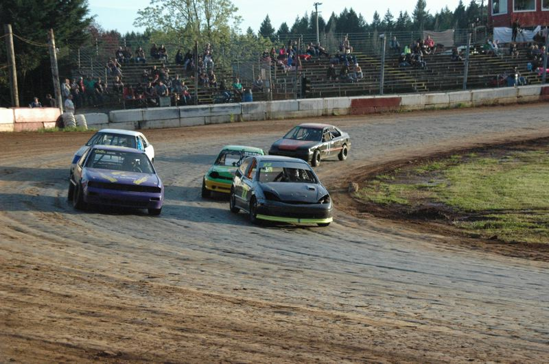 COURTESY PHOTO: MIKE WEBER - Lance Landis (No. 22, on the inside) of West Linn and Joel Davis (04, on the outside) lead the Tuner Division main event during the May 11 races at River City Speedway.