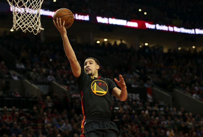 PMG FILE PHOTO: DAVID BLAIR - Klay Thompson of the Golden State Warriors gets to the rim in a game against the Trail Blazers.
