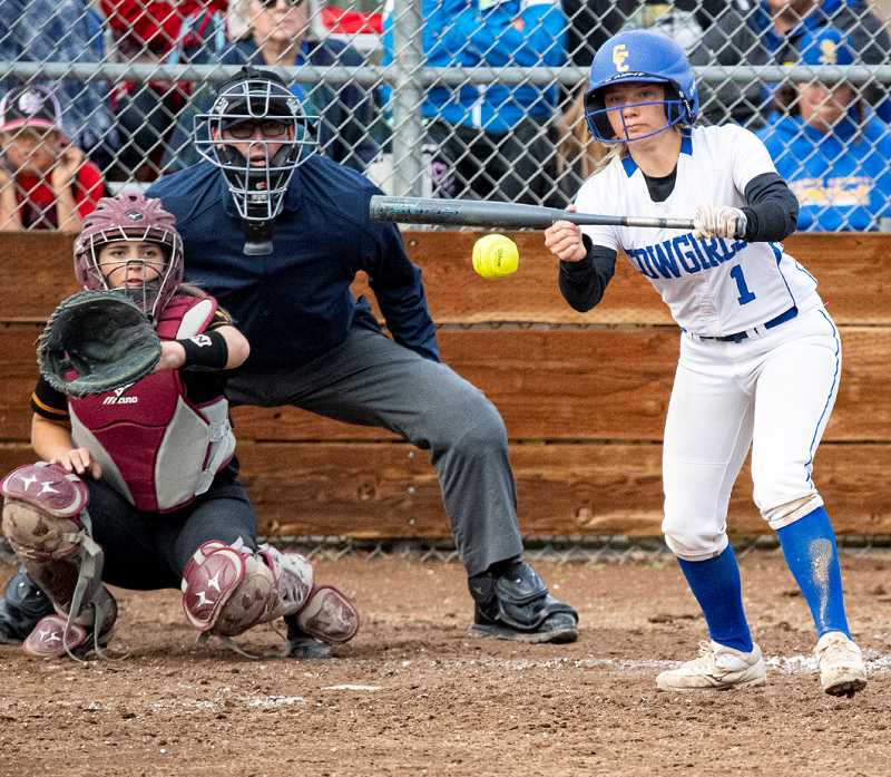 LON AUSTIN/CENTRAL OREGONIAN - Caitlyn Elliott lays down a bunt in the bottom of the seventh inning. The bunt scored Ashley Owens with the game-winning run as the Cowgirls edged the Redmond Panthers 14-13 in the final game of the year for both teams.