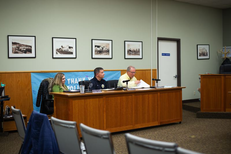 PMG PHOTO: ANNA DEL SAVIO - Scappoose Police Chief Norm Miller, center, sits between Alexandra Rains, assistant to City Manager Michael Sykes, right, at a City Council meeting. City staff have recommended amending the existing noise ordinance to clarify enforcement.