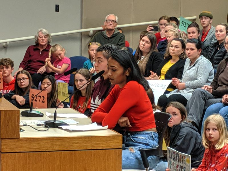 PMG PHOTO: COURTNEY VAUGHN - Sriya Chinnam addresses Portland Public Schools directors about climate change literacy Tuesday, May 14. Seated next to her is Kaiya Yonamine, who also spoke.