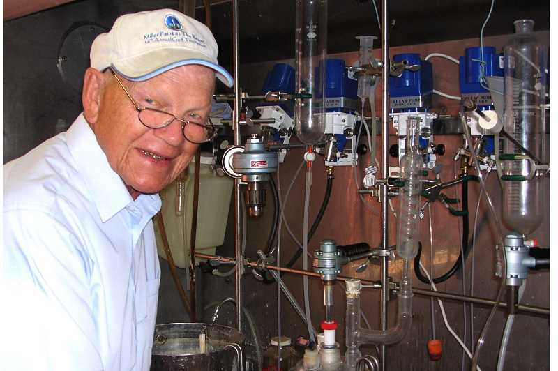 COURTESY OF SPECIALTY POLYMER - Raymond Southwell working in the lab in 2004.