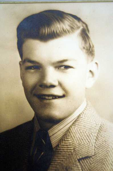 COURTESY OF SPECIALTY POLYMER - Raymond Southwell's senior photos as a 1944 Molalla High School graduate.