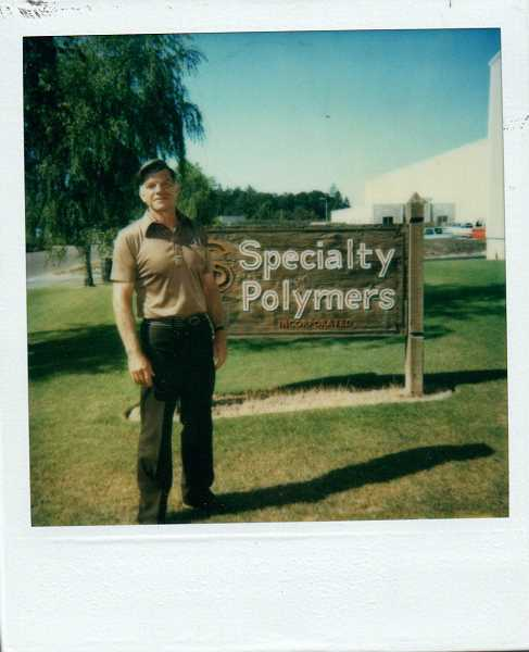 COURTESY OF SPECIALTY POLYMER - A 1975 photo of Raymond Southwell posing by a Specialty Polymers sign in Woodburn.