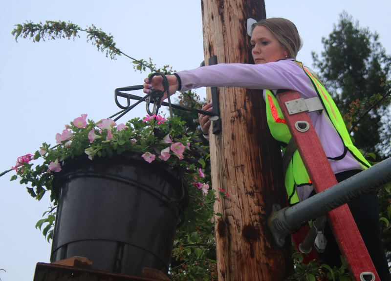 Ashley Coke prepares to hook a basket in downtown Lake Oswego on Saturday, May 18.
