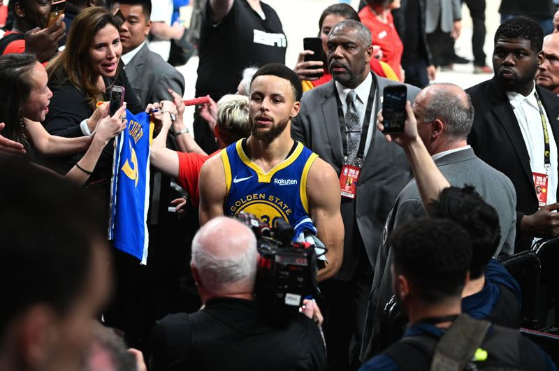 PMG PHOTO: CHRISTOPHER OERTELL - Stephen Curry leaves the Moda Center court Saturday after Game 3, won by his Golden State Warriors over the Trail Blazers 110-99.