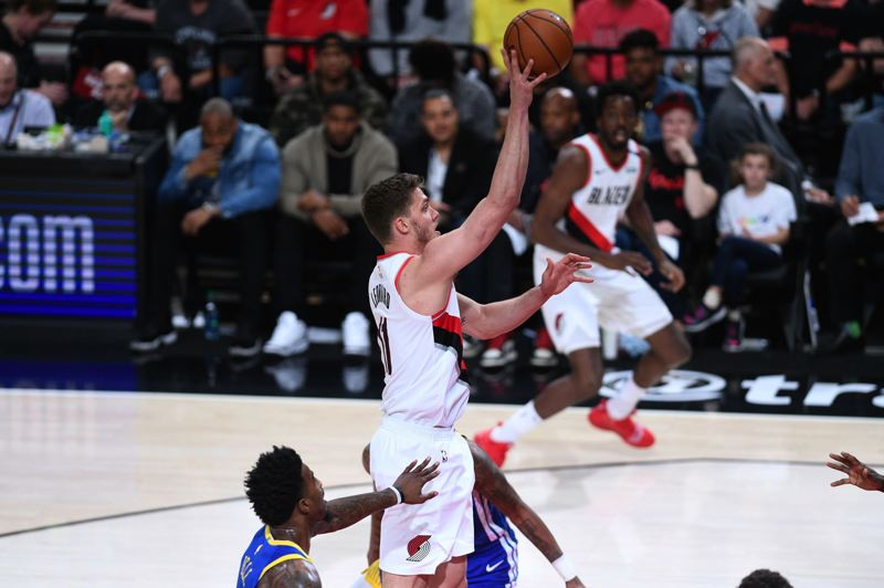 PMG PHOTO: CHRISTOPHER OERTELL - Surprise starting center Meyers Leonard goes up for a shot in Game 3 on Saturday night as the Trail Blazers take a big lead, then fall to the Golden State Warriors at Moda Center.