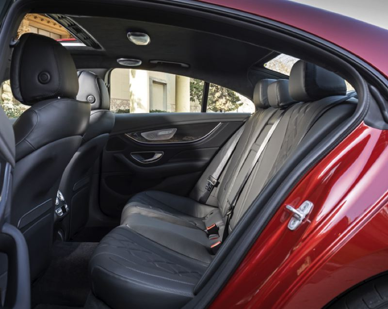 COURTESY MERCEDES-BENZ - Rear seat passengers ride in luxury in the 2019 Mercedes CLS450 4Matic Coupe.