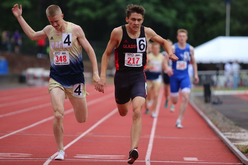PMG PHOTO: JIM BESEDA - Gladstone's Konnor Hathaway (217) edged Marist Catholic's Jack Crowell by one-tenth of a second in the boys 800-meter run at Saturday's OSAA Class 4A track and field state championships.
