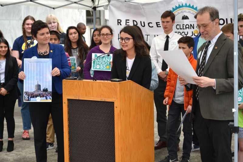 COURTESY PHOTO: AUBREY WIEBER/OREGON CAPITAL BUREAU - Rep. Karin Power, D-Milwaukie, and Sen. Michael Dembrow, D-Portland, leaders of the cap-and-trade proposal, speak at a rally outside the Capitol.