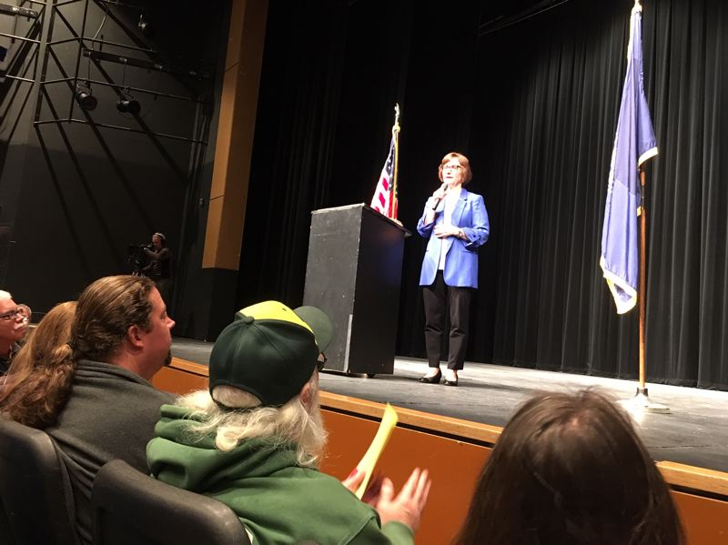PMG PHOTO BY PETER WONG - U.S. Rep. Suzanne Bonamici, D-Ore., fields questions during a town hall meeting attended by about 200 people on April 23 at Century High School in Hillsboro.