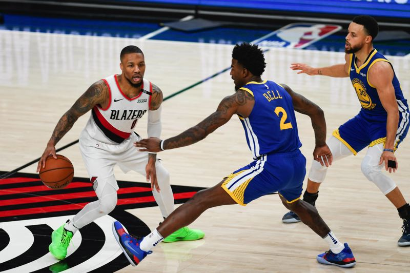 PMG PHOTO: CHRISTOPHER OERTELL - Golden State players Jordan Bell and Stephen Curry (right) come well out into the backcourt in defense of Trail Blazers guard Damian Lillard during Game 3 of their NBA Western Conference finals.