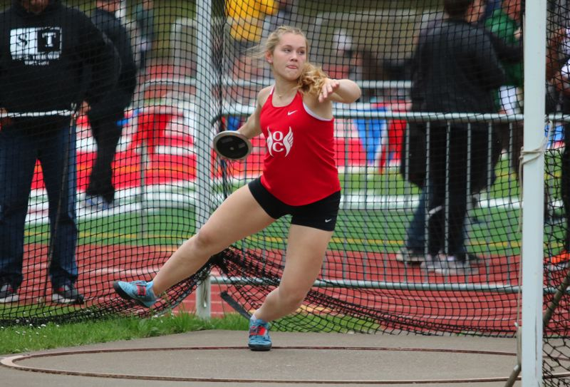 PMG PHOTO: JIM BESEDA - Oregon City junior Anessa Chirgwin won the girls discus district title with a throw of 147 feet, 8 inches during Friday's Three Rivers League track and field championships at Oregon City.