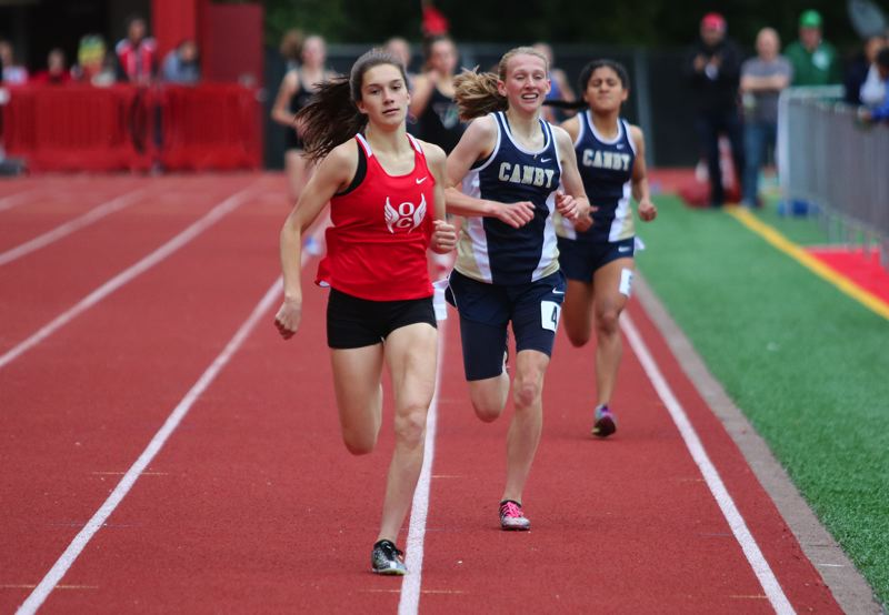 PMG PHOTO: JIM BESEDA - Oregon City's Anya Remsburg passed Canby's Izabela Kacalek around the final turn and pulled away to win the girls 800-meter run in a personal best 2 minutes, 17.35 seconds Friday.