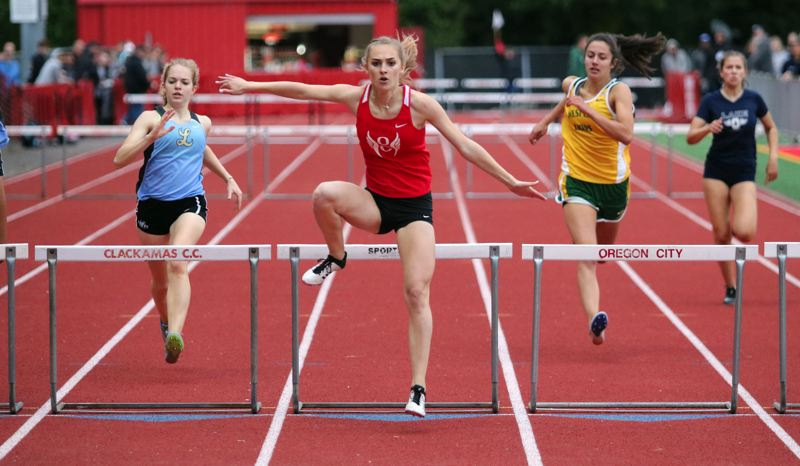 PMG PHOTO: JIM BESEDA - Top-seeded Alexis Pearson of Oregon City (center) won the girls 300-meter hurdles in 47.58 seconds in qualifying for the OSAA Class 6A track and field championships beginning Friday.