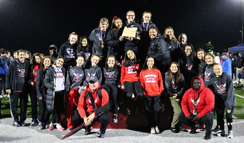 PMG PHOTO: JIM BESEDA - Clackamas outscored Centennial 115-104 to claim the girls team title Wedneday night at the Mt. Hood Conference track and field district championships at Sandy High School.