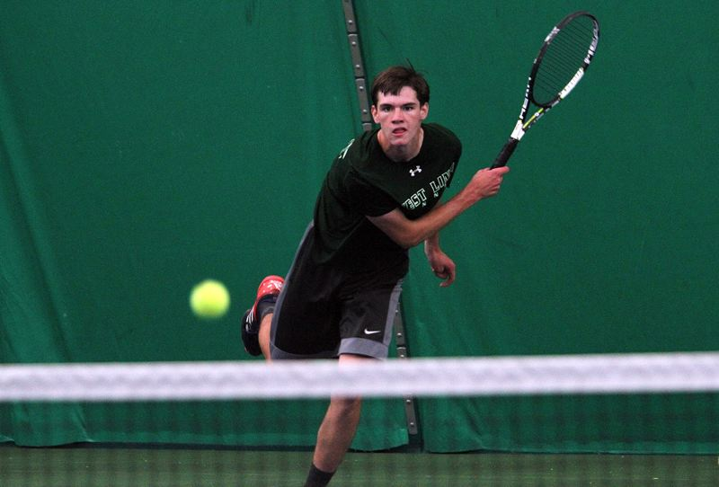 PMG PHOTO: MILES VANCE - West Linn junior Logan Thompson follows through after making a serve in his second-round loss in the Class 6A state tournament at the Babette Horenstein Tennis Center on Thursday, May 16.