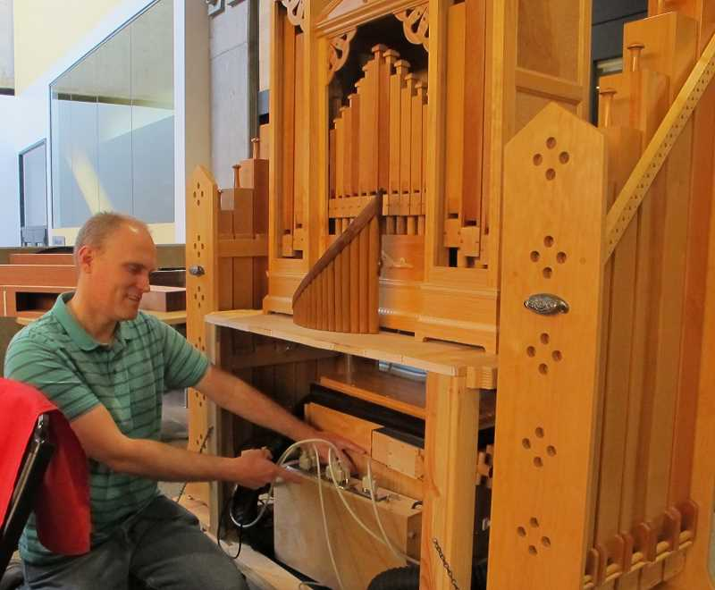 Sean Koreski shows off the electronics for his organ that make it function like 'his personal orchestra.'