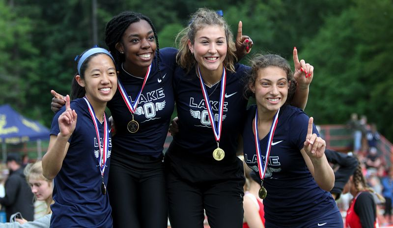PMG PHOTO: MILES VANCE - Lake Oswego's (from left) Erica Chiang, Gemma Pleas, Maddie DeBorde and Sophie Smith are all smiles after winning the 4 x 100-meter relay at the Three Rivers League district track meet at Oregon City's Pioneer Memorial Stadium on Friday, May 17.