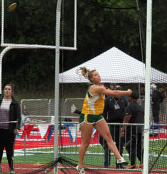 PMG PHOTO: MILES VANCE - West Linn sophomore Makayla Long makes a throw in the discus competition during the Three Rivers League district meet at Oregon City's Pioneer Memorial Stadium on Friday, May 17.