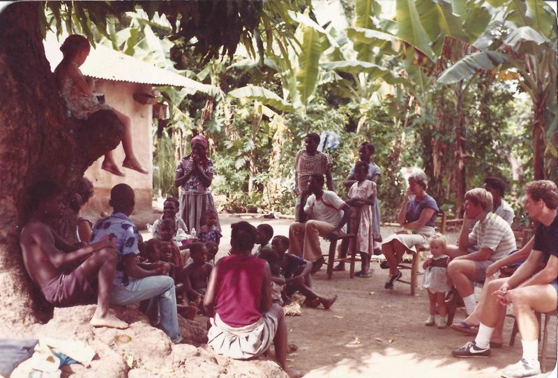 COURTESY PHOTO - Apricot Irving sits in a tree while socializing with Haitian children during her familys missionary work in Haiti.
