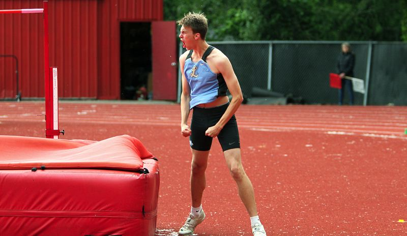 PMG PHOTO: MILES VANCE - Lakeridge senior Calvin Migchelbrink lets out a yell after clearing a height en route to his win in the high jump at the Three Rivers League district track meet at Oregon City's Pioneer Memorial Stadium on Friday, May 17.