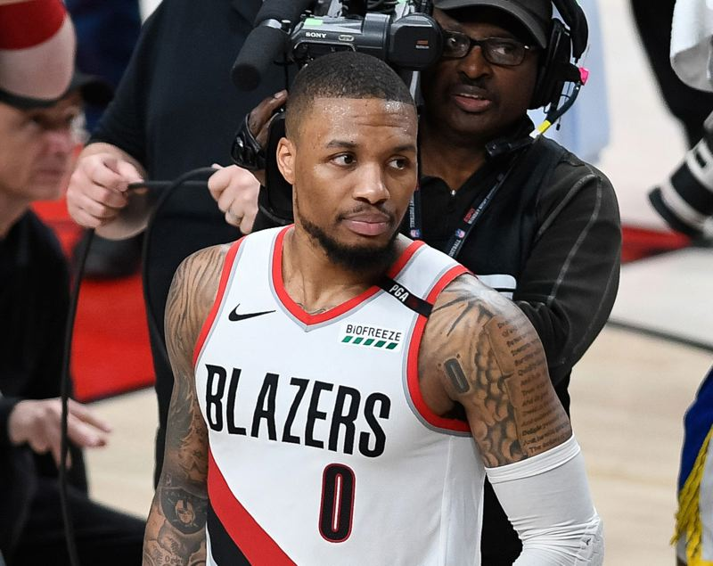 PMG PHOTO: CHRISTOPHER OERTELL - Trail Blazers All-Star Damian Lillard takes a wistful look back before leaving the floor at Moda Center on Monday, moments after Portland's season ended with an overtime loss to Golden State in Game 4 of the NBA Western Conference finals.