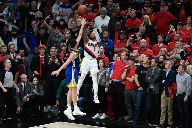 PMG PHOTO: CHRISTOPHER OERTELL - The last shot of a long season: Damian Lillard of the Trail Blazers goes for the win, as Golden State's Klay Thompson defends. Lillard's 3-pointer in the final seconds of overtime fell short, and the Warriors advanced to the NBA Finals with a 119-117 Game 4 victory Monday at Moda Center and 4-0 Western Conference finals sweep.