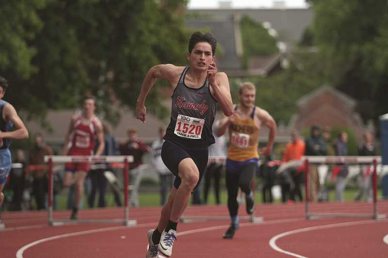 PMG PHOTO: PHIL HAWKINS - Kennedy senior Carlos Saravia won the first hurdle title in school history, placing first in the 300-meter hurdle race at the 2019 2A Track and Field State Championships on Saturday.