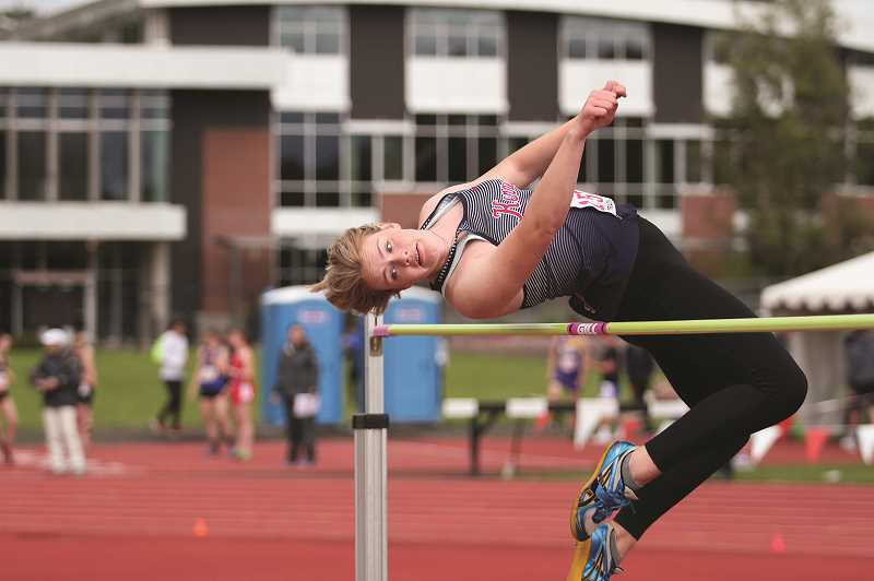 PMG PHOTO: PHIL HAWKINS - Kennedy senior Hallie Sprauer scored 22 points for the Trojans, placing runner up in the high jump and triple jump in addition to a third-place finish in the long jump at the 2A state meet.