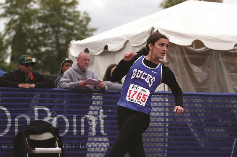 PMG PHOTO: PHIL HAWKINS - St. Paul senior Rachel Vela won a virtual three-way tie in the 1A 100-meter dash on Saturday, separating herself by 0.007 seconds to place third with a PR-time of 12.97