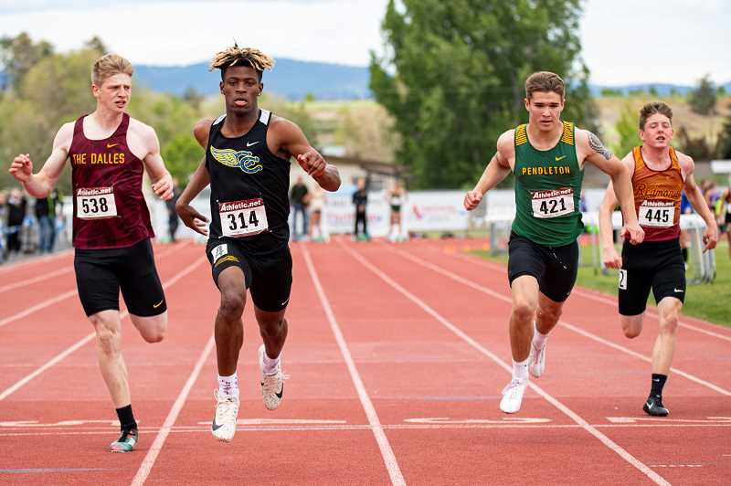 LON AUSTIN/CENTRAL OREGONIAN - Zach Guthrie wins the 100 meter dash finals at the Intermountain Conference meet. Guthrie won three individual events and ran leadoff on the Cowboys winning 4x400 relay team earning him the outstanding male athlete of the meet award.