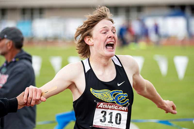 LON AUSTIN/CENRAL OREGONIAN - Miles Chaney celebrates after winning the 800 meter run at the IMC championships.