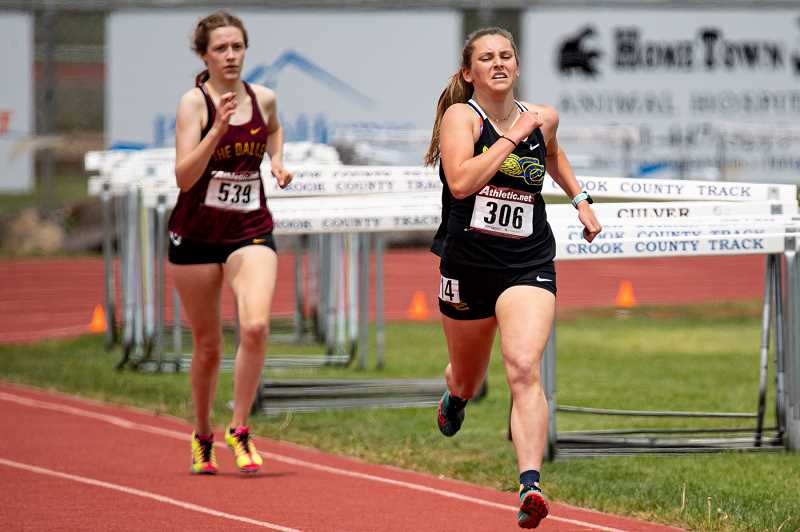 LON AUSTIN/CENTRAL OREGONIAN - Jan Carne sprnts away from a runner from The Dalles on her way to a second place finish in the 1,500. Carne ran a personal record time of 5:04.66 in the race. Carne also placed fourth in the 800.