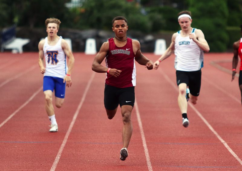 PMG PHOTO: DAN BROOD - Sherwood High School junior Caleb Hagan, shown here in the preliminaries for the 200-meter dash, won both the 100 and 200 at the Pacific Conference district track and field championships.