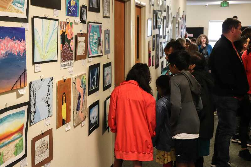 COURTESY PHOTO: ANDREW KILSTROM - Community members browse student artwork during the districtwide art show at Arts and Technology High School May 18.