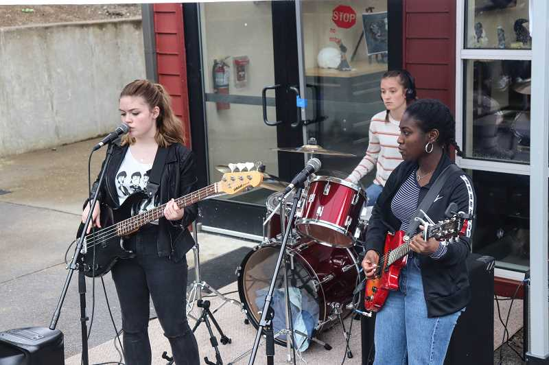 COURTESY PHOTO: ANDREW KILSTROM - Gillian McMahon, left, performs as part of a West Linn High School band during the art show.
