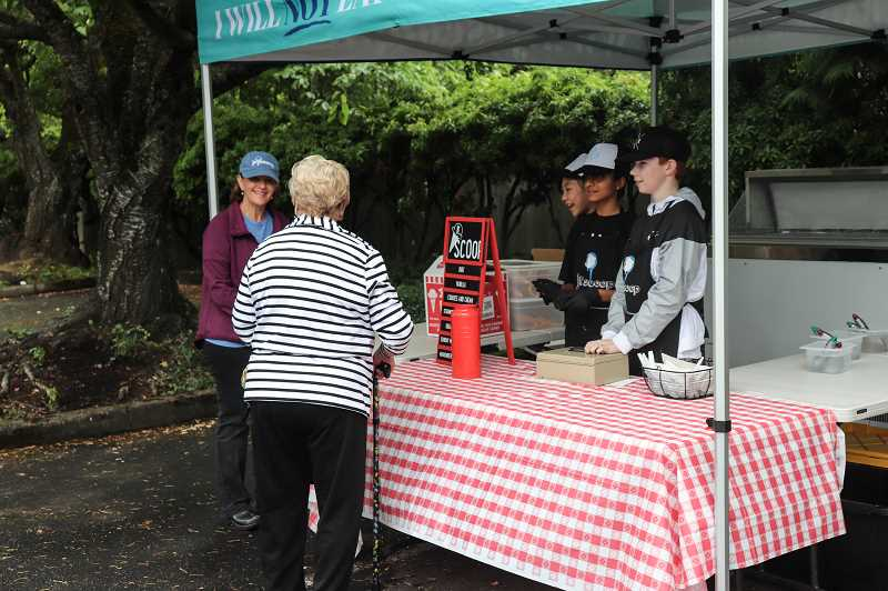 COURTESY PHOTO: ANDREW KILSTROM - Jr. Scoop serves up a treat to community members.