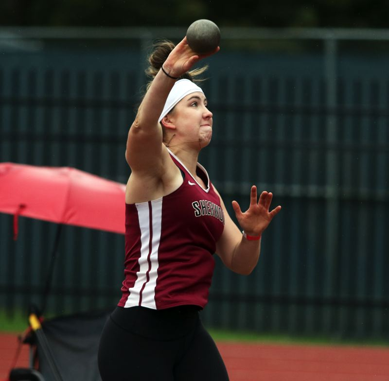 PMG PHOTO: DAN BROOD - Sherwood High School senior Korynn Bowers took second place in the shot put event at the Pacific Conference district track and field championships.