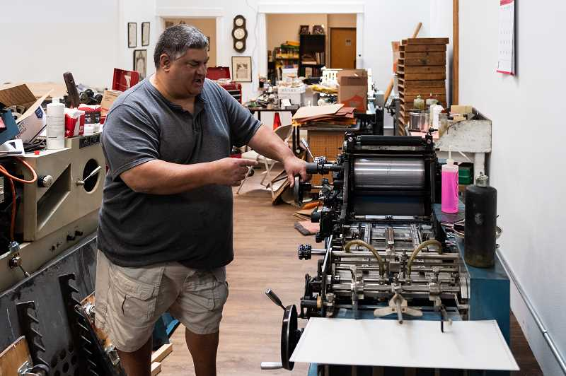 PMG PHOTO: CHRISTOPHER OERTELL - The equipment used at Gann Bros. has been in use for decades. Staff at the printing shop say using the presses is like using a piece of history.