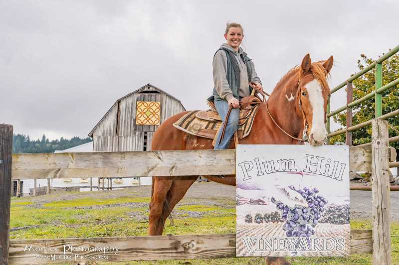 COURTESY PHOTO - Outside of her work at Plum Hill, Shannon Carrigan enjoys spending time with her many farm animals including her horses Pinot and Thunder. Pinot was adopted by Carrigan after participating in the Teens and Oregon Mustangs 100-day training competition.