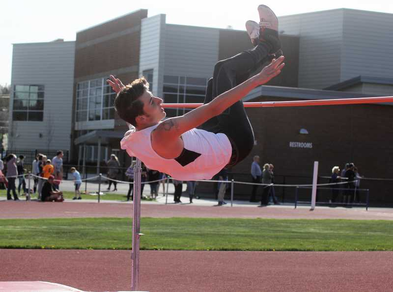 STEELE HAUGEN - Kash Michael has a leap of 6-02 at the state meet, claiming silver for the Bulldogs.