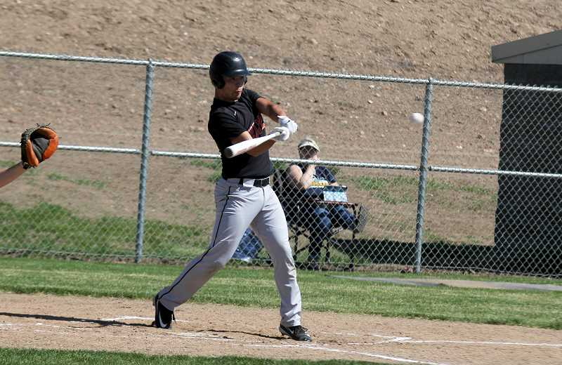STEELE HAUGEN - Joe Russo hit a triple during the Bulldogs' 13-1 first round playoff win.