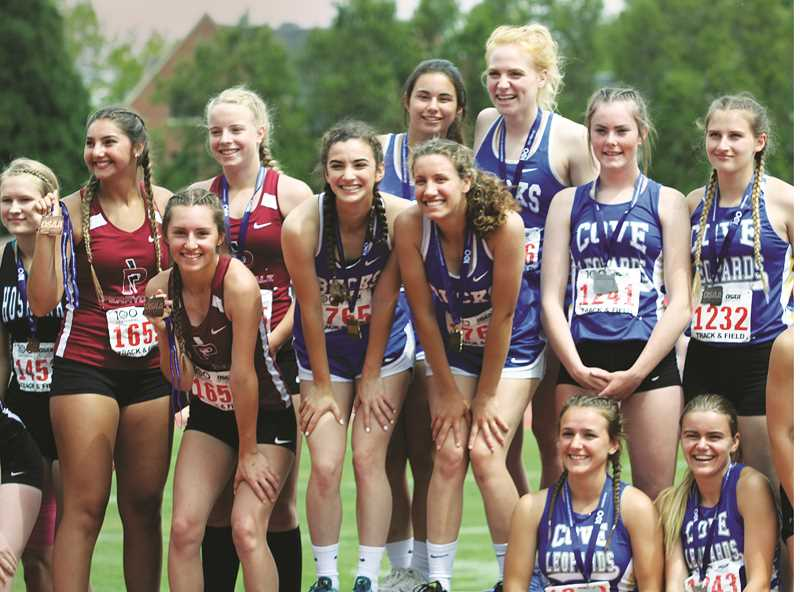 WOODBURN INDEPENDENT PHOTO: PHIL HAWKINS - St. Paul's Rachel Vela, Taysha Veeman, Sadie Smith and Isabelle Wyss won 1A state titles in the 4 x 100 meter and 4 x 400 meter relays on Saturday.