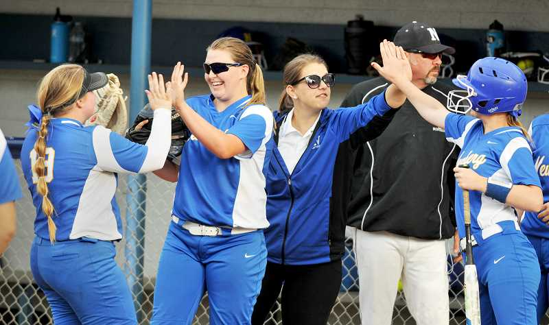 GRAPHIC PHOTO: GARY ALLEN - With the support of Coach Angela Stutzman, who's been away from the team due to health issues, Newberg softball won its opening round playoff game.